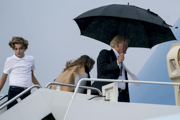 <em>President Donald Trump made sure he didn't get wet – unlike first lady Melania Trump (AP)</em>