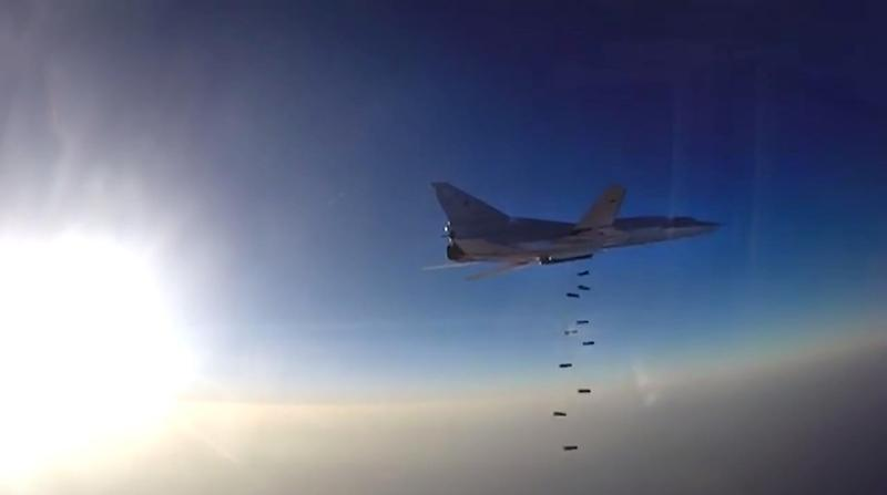 An image grab created on August 16, 2016, from footage released by the Russian defence ministry reportedly shows a Russian Tupolev Tu-22M3 conducting an air strike in Syria