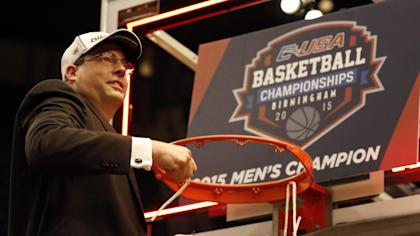 Jerod Haase cuts a piece of the net after UAB won the C-USA tournament. (AP)