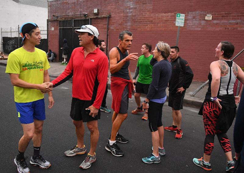 The Midnight Runners club offers its members a therapeutic outlet as they battle to overcome years of addiction to drugs or alcohol, as well as homelessness (AFP Photo/Mark RALSTON)