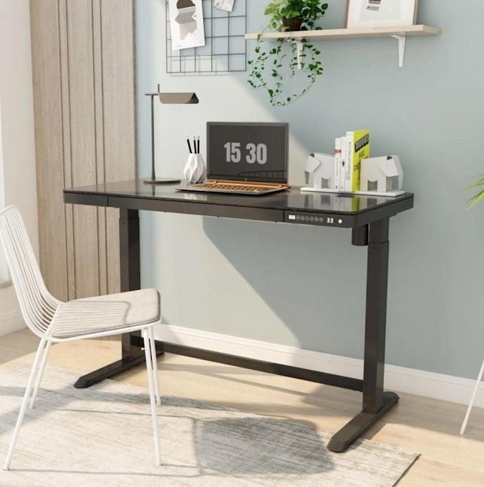 """<p>""""As I approach one year of working from home (at my kitchen dining table), I was so excited when Flexispot sent me a <span> All-in-One Standing Desk</span> ($430, previously $500) to test out. This desk is a great size (48"""" by 24""""), especially if you're adding it to a smaller room or bedroom. The height is adjustable from 28.3"""" to 47.6"""" and you can customize it with four different preset heights. I'm grateful that it encourages me to stand, which makes me feel more energized and productive, but is also just one click away to adjust back down to chair level for when I need to do concentrated work. - GFR</p>"""