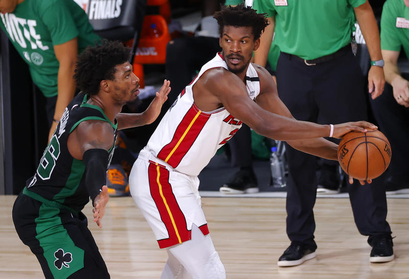 Jimmy Butler #22 of the Miami Heat handles the ball as Marcus Smart #36 of the Boston Celtics defends during the third quarter in Game Two of the Eastern Conference Finals.