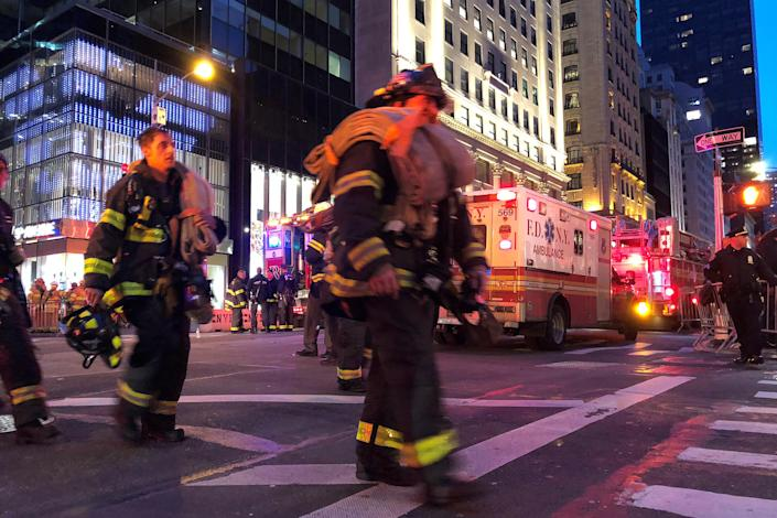 <p>First responders work on a fire at Trump Tower in the Manhattan borough of New York City, New York, April 7, 2018. (Photo: Catherine Koppel/Reuters) </p>