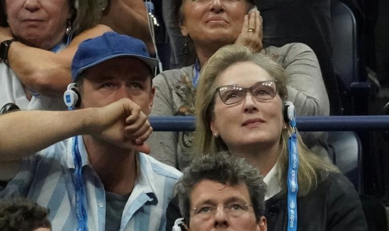Actress Meryl Streep absorbed in the tense second-set battle between Novak Djokovic and Juan Martin del Potro in the US Open final