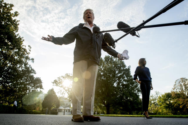 <p>President Donald Trump, accompanied by first lady Melania Trump, speaks to reporters as he walks to board Marine One on the South Lawn of the White House in Washington, Tuesday, Oct. 3, 2017, for a short trip to Andrews Air Force Base, Md. and then on to Puerto Rico. (Photo: Andrew Harnik/AP) </p>