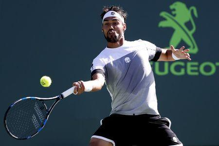 Mar 29, 2017; Miami, FL, USA; Fabio Fognini of Italy hits a forehand against Kei Nishikori of Japan (not pictured) on day nine of the 2017 Miami Open at Crandon Park Tennis Center. Fognini won 6-4, 6-2. Geoff Burke-USA TODAY Sports