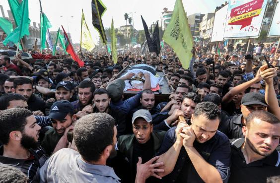 Mourners carry the body of Baha Abu Al-Ata during his funeral in Gaza City (Mahmud Hams/AFP/Getty)