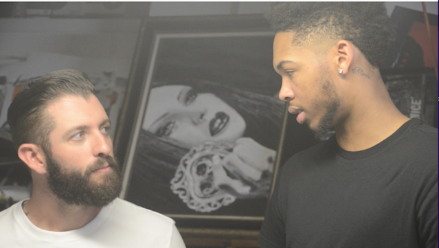 Ingram and Never talk art at Never's garage studio. (Jackie Bamberger/Yahoo Sports)