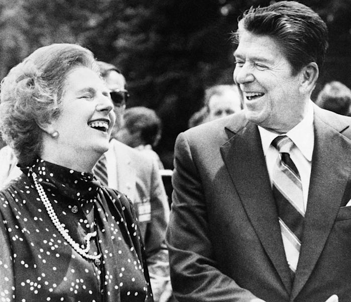 FILE - U.S. President Ronald Reagan, right, and Britain's Prime Minister Margaret Thatcher, share a laugh during a break from a session at the Ottawa Summit in this file photo dated July 21, 1981, at Government House in Ottawa, Canada.  Personal papers from 1981 released Saturday March 17, 2012, by the Thatcher archive at Cambridge University in England, reveal that Thatcher was fascinated by U.S. President Reagan, and that she snatched and kept a page of his doodles from this G7 summit in Ottawa. Reagan left the piece of paper adorned with his sketches, sitting on a table at the Ottawa meeting when Margaret Thatcher picked it up and kept it, it is revealed in her papers released Saturday. (AP Photo/File)