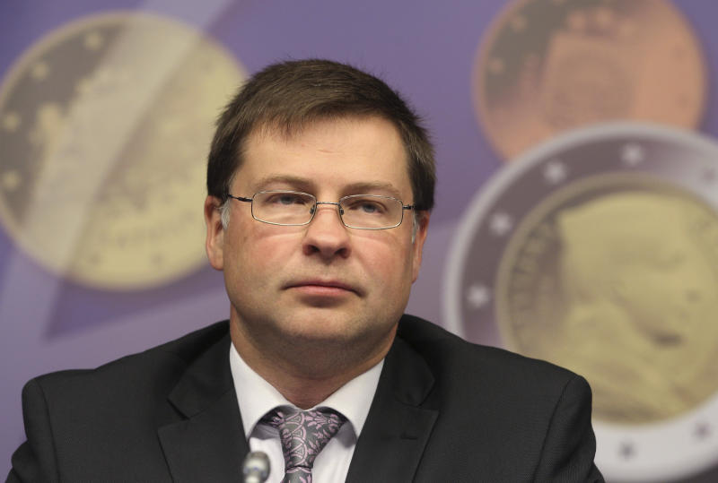 FILE - In this July 9, 2013, photo, Latvian Prime Minister Valdis Dombrovskis addresses the media on the adoption of the euro, at the European Council building in Brussels. Dombrovskis has resigned after accepting political responsibility for the collapse of a supermarket roof in Riga, Latvia, that killed 54 people and wounded at least 40 others. He was the longest serving prime minister in Latvia's history. (AP Photo/Yves Logghe, File)