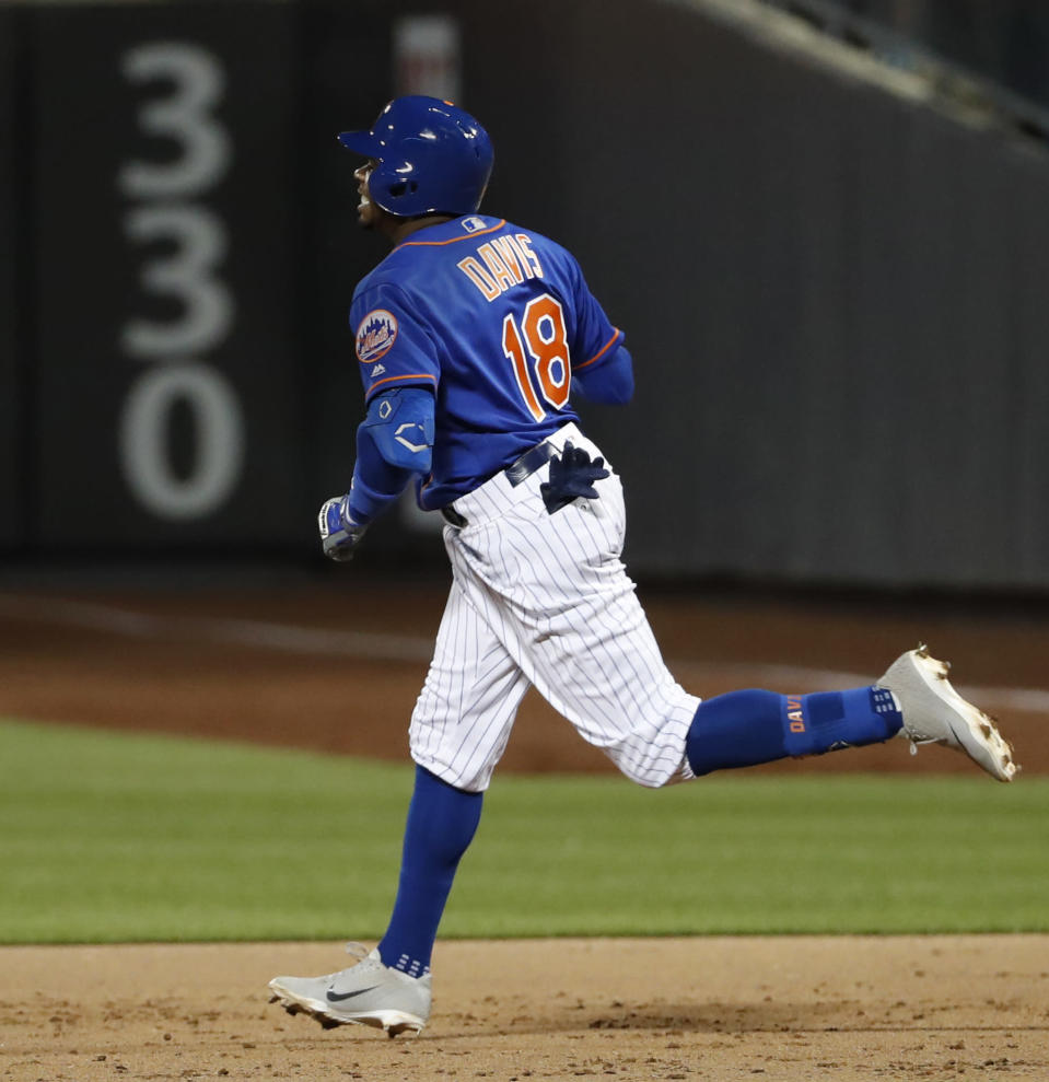 New York Mets' Rajai Davis runs the bases after hitting a three-run home run during the eighth inning of the team's baseball game against the Washington Nationals, Wednesday, May 22, 2019, in New York. (AP Photo/Kathy Willens)