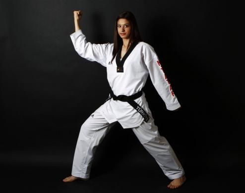 Turkish Taekwondo fighter and Olympic hopeful Nur Tatar, 20, poses in Ankara May 24, 2012.