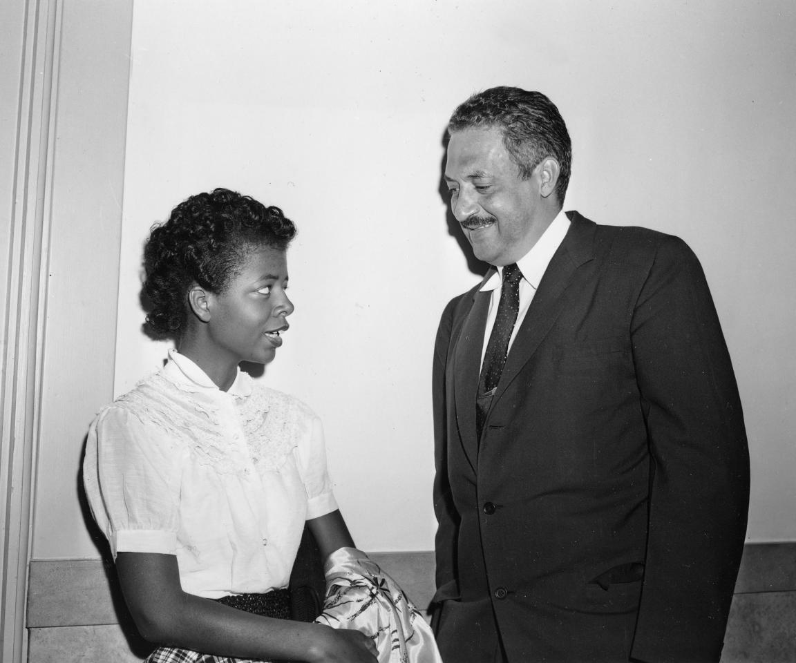 Thurgood Marshall, right, chief legal counsel of the National Association for the Advancement of Colored People (NAACP), talks with student Elizabeth Eckford in the corridor of the Federal Courthouse at Little Rock, Ark., where a hearing on the integration case of Central High School is being held, Sepember 7, 1954. 15-year old Elizabeth was the first of nine black students to attempt to enter the school on opening day, only to be turned away by Arkansas National Guard troops following orders of Gov. Orval Faubus to block the main entrance. (AP Photo)