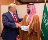 FILE PHOTO: Saudi Arabia's Crown Prince Mohammed bin Salman shakes hands with U.S. President Donald Trump, at the G20 leaders summit in Osaka
