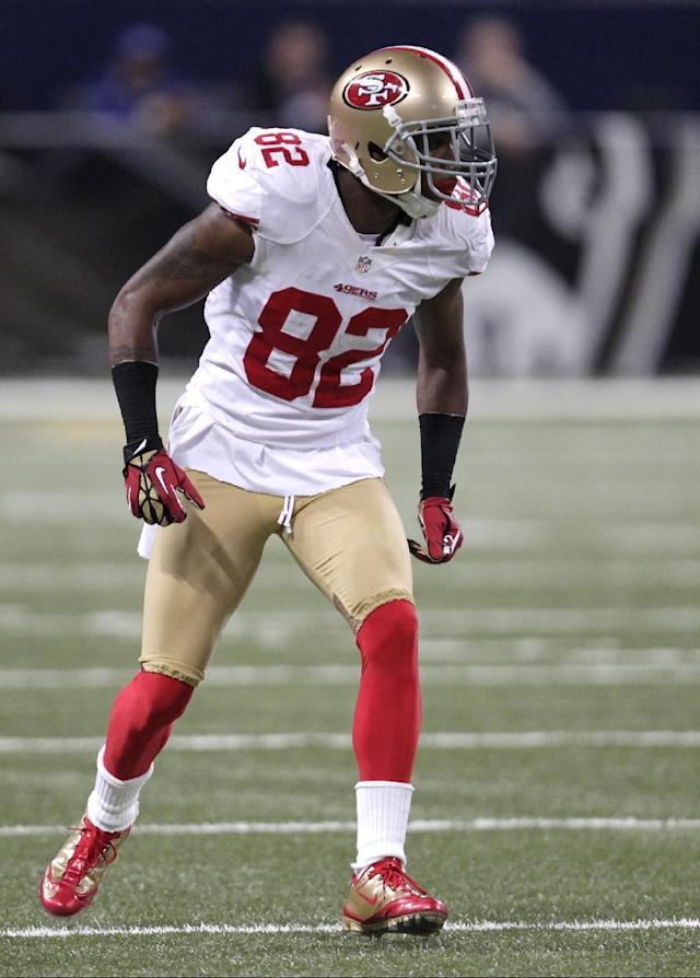 San Francisco 49ers wide receiver Mario Manningham (82) gets set for the play during the second half of an NFL football game against the St. Louis Rams Sunday, Dec. 2, 2012, in St. Louis. The Rams won 16-13 in overtime. (AP Photo/Tom Gannam)