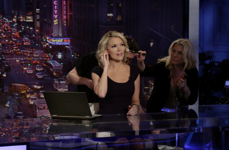 """Megyn Kelly, host of Fox News Channel's """"The Kelly Files,"""" gets a make-up touch-up during rehearsals for the debut of her new prime-time show, in New York, Friday, Oct. 4, 2013. Her program is the linchpin to the first overhaul of Fox's prime-time lineup since 2002, or about a century in television time. (AP Photo/Richard Drew)"""