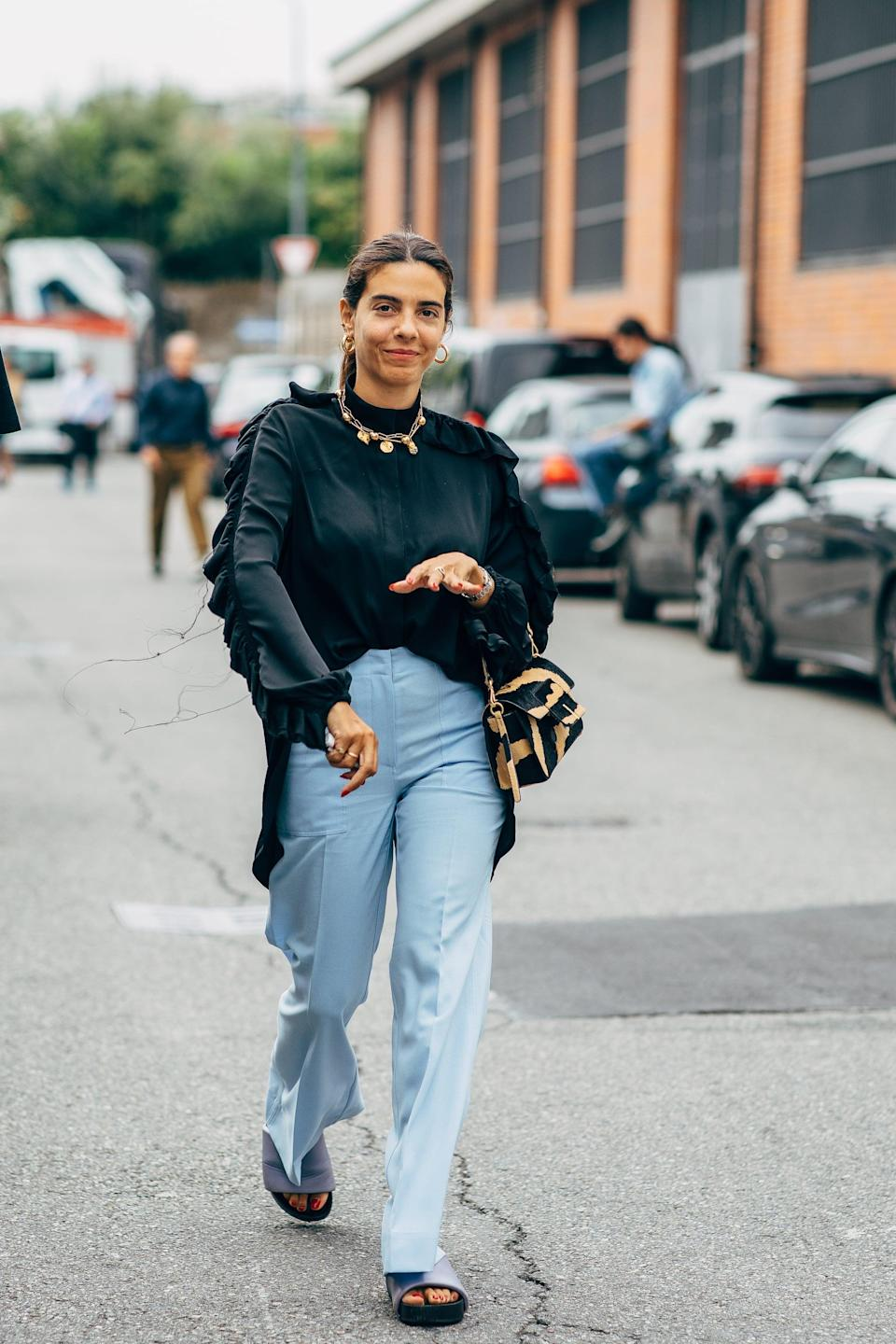 <p>Top your favorite jeans with a statement top and necklace, but keep your footwear laidback. </p>