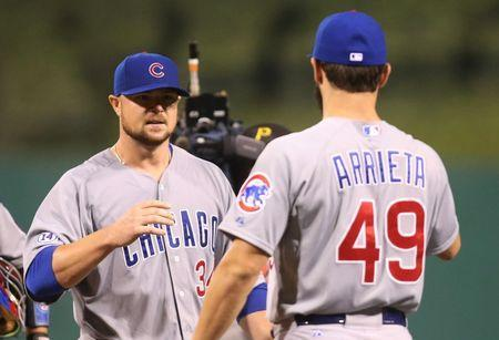 Sep 15, 2015; Pittsburgh, PA, USA; Chicago Cubs starting pitcher Jon Lester (34) celebrates with pitcher Jake Arrieta (49) after a complete game against the Pittsburgh Pirates at PNC Park. Mandatory Credit: Charles LeClaire-USA TODAY Sports