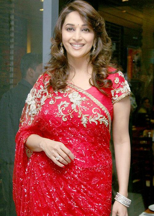 <b>6.Madhuri Dixit:</b> Queen of smiles, Madhuri has lately been spotted donning Anarkalis, but this one tells us she's well aware of the shimmer in the fashion world as well!
