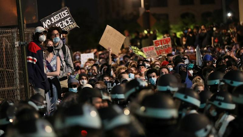 Protesters defied an 8pm curfew in New York to voice their anger over the death of George Floyd