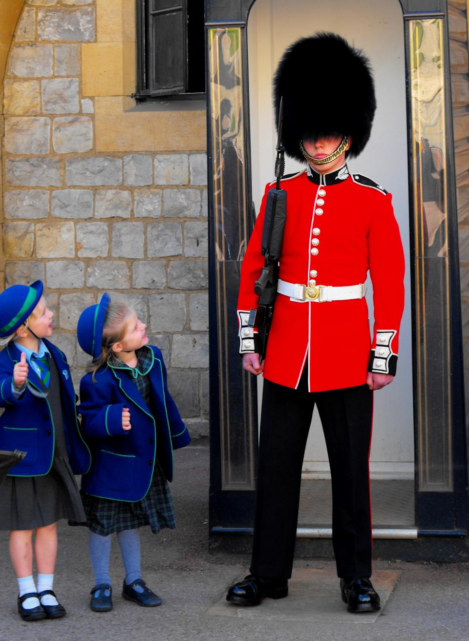 """<b>Windsor Castle Guard</b><br> I ran into a group of schoolchildren visiting Windsor Castle in early October. A few of the girls particularly enjoyed posing with the guard.<br> Photograph by <a href=""""http://ngm.nationalgeographic.com/myshot/gallery/359626"""" rel=""""nofollow noopener"""" target=""""_blank"""" data-ylk=""""slk:Robin Flynn"""" class=""""link rapid-noclick-resp"""">Robin Flynn</a>, <a href=""""http://ngm.nationalgeographic.com/myshot/"""" rel=""""nofollow noopener"""" target=""""_blank"""" data-ylk=""""slk:My Shot"""" class=""""link rapid-noclick-resp"""">My Shot</a>"""