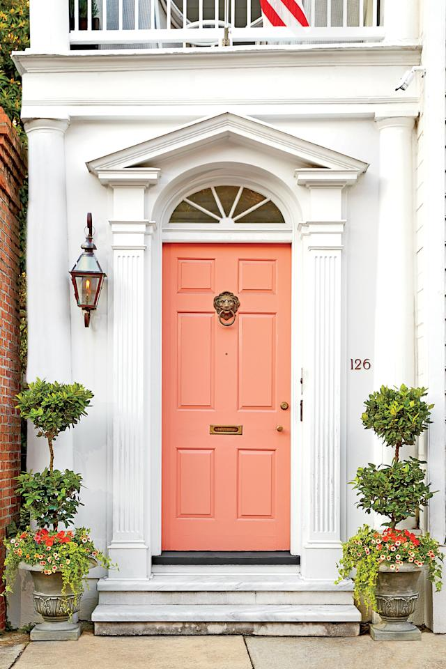 """<p>Used as a bold centerpiece, like on this pretty front door, coral is eye-catching and so very inviting. Choose a vibrant shade, and you'll instantly add personality to an otherwise lackluster facade. Here, the paint color is Gumdrops (P210-3) by Behr <em>(</em><a href=""""https://www.behr.com/consumer/ColorDetailView/P210-3"""" target=""""_blank""""><em>behr.com</em></a><em>).</em></p>"""