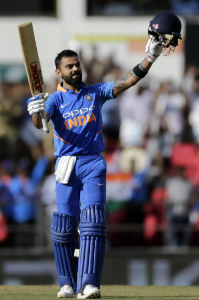 FILE - In this Tuesday March 5, 2019 file photo, India's Virat Kohli celebrates his hundred during the second one-day international cricket match between India and Australia in Nagpur, India. The 2019 Cricket World Cup starts in England on May 31. (AP Photo/Rajanish Kakade, File)