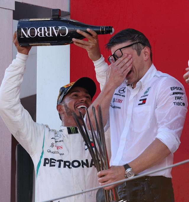 Formula One F1 - Spanish Grand Prix - Circuit de Barcelona-Catalunya, Barcelona, Spain - May 13, 2018 Mercedes' Lewis Hamilton sprays champagne as he celebrates on the podium after winning the race REUTERS/Albert Gea