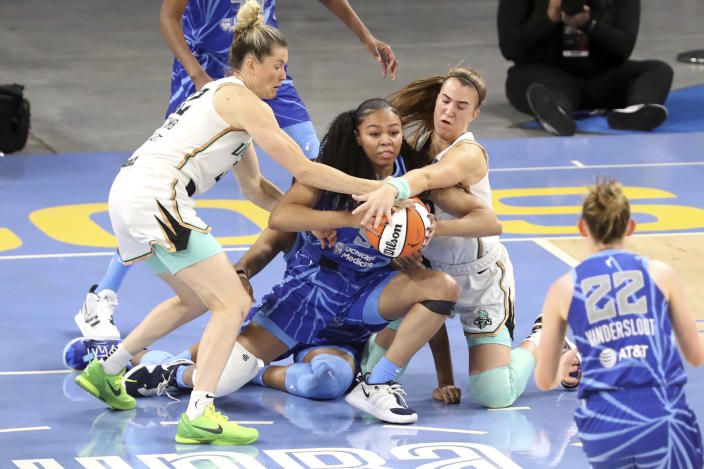 New York Liberty guard Sabrina Ionescu. upper right, and guard Sami Whitcomb, left, battle Chicago Sky guard Stephanie Watts, center, for the ball during a WNBA basketball game Sunday, May 23, 2021, in Chicago. (AP Photo/Eileen T. Meslar)
