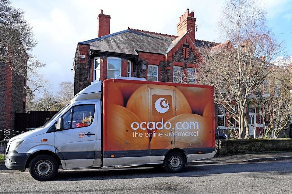 An Ocado delivery van parks outside a residential address near Liverpool in north-west England during a delivery of food and drink for supermarket Waitrose. Photo: Paul Ellis/AFP/Getty Images