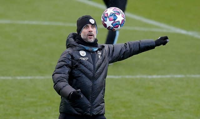 Pep Guardiola is looking for a sixth straight domestic trophy (Martin Rickett/PA)