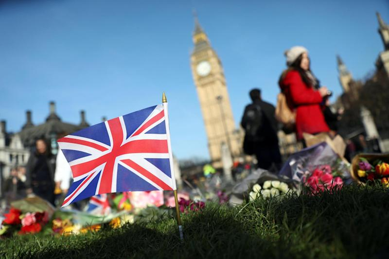 Poignant: Flowers were left at the scene in Westminster: REUTERS