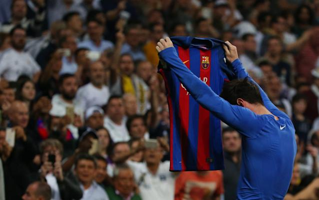 <span>Messi holds his shirt up to celebrate his winner</span> <span>Credit: Reuters </span>