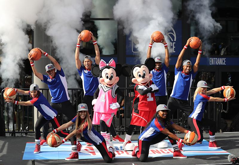 Mickey Mouse and Minnie with dancers during the opening day for NBA Experience, a basketball-driven interactive attraction at Disney Springs in Orlando, Fla., on August 12, 2019. (Ricardo Ramirez Buxeda/Orlando Sentinel/Tribune News Service via Getty Images)