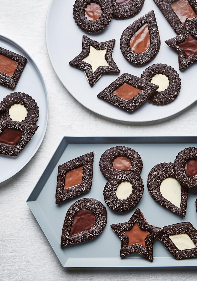 """Melt tahini with chocolate in whatever shade you please for a glossy bittersweet filling that will sandwich together rich cocoa shortbreads. As long as you have one large and one small cookie cutter, they don't have to be the same shape. Feel free to mix and match diamonds, squares, and teardrops. <a href=""""https://www.bonappetit.com/recipe/chocolate-tahini-linzer-cookies?mbid=synd_yahoo_rss"""">See recipe.</a>"""