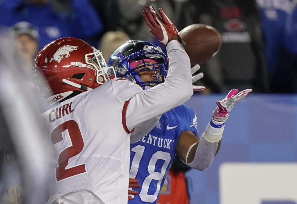 Kentucky wide receiver Clevan Thomas Jr. (18) catches a touchdown pass during the second half of an NCAA college football game against Arkansas on Saturday, Oct. 12, 2019, in Lexington, Ky. (AP Photo/Bryan Woolston)