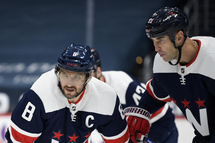 Washington Capitals left wing Alex Ovechkin (8), of Russia, and defenseman Zdeno Chara (33) wait for a faceoff during the first period of an NHL hockey game against the Philadelphia Flyers, Sunday, Feb. 7, 2021, in Washington. (AP Photo/Nick Wass)