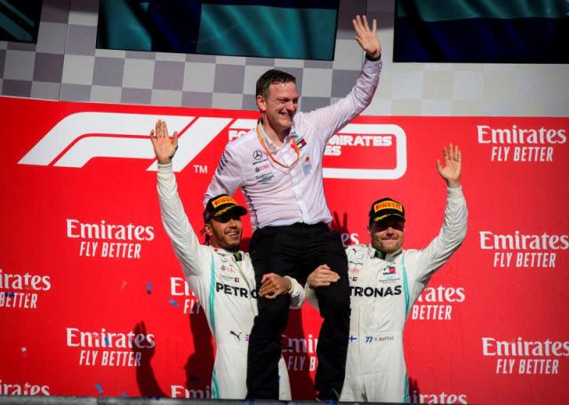 FILE PHOTO: Mercedes designer James Allison is lifted up by Mercedes drivers Lewis Hamilton (left) and Valtteri Bottas (right) during the 2019 United States Grand Prix at Circuit of the Americas