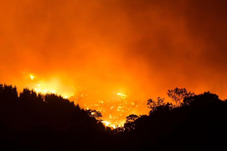 A picture from the village of Cartajima shows the wildfire burning in the Sierra Bermeja mountain range  (AFP via Getty Images)