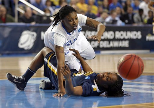 Delaware guard Akeema Richards, top, and West Virginia guard Linda Stepney struggle for possession of the ball during the first half of a first-round game in the women's NCAA college basketball tournament in Newark, Del., Sunday March 24, 2013. (AP Photo/Patrick Semansky)