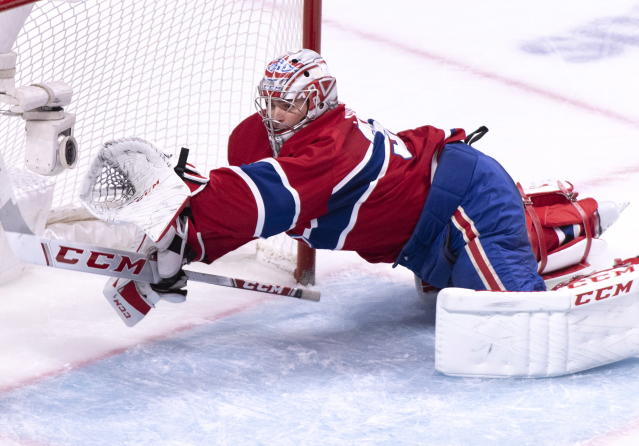 Montreal Canadiens goaltender Carey Price spins around to cover the net during the second period of an NHL hockey game against the Carolina Hurricanes on Tuesday, Nov. 27, 2018, in Montreal. (Paul Chiasson/The Canadian Press via AP)