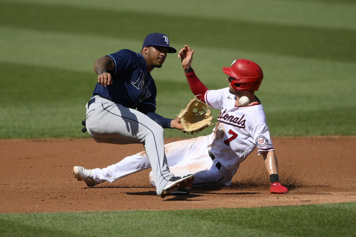Washington Nationals' Trea Turner (7) slides on his way to stealing second against Tampa Bay Rays shortstop Wander Franco, left, during the first inning of a baseball game, Wednesday, June 30, 2021, in Washington. (AP Photo/Nick Wass)