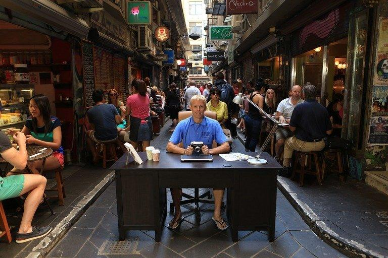 Briton Ben Southall is seen sitting behind a desk in a Melbourne laneway, on March 5, 2013