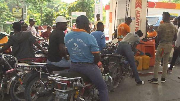 PHOTO: With shortages of food and fuel commonplace in Haiti, people gather to fill up. (ABC)