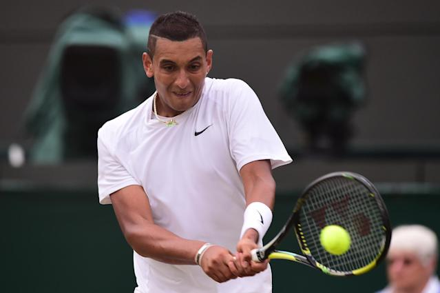 Australia's Nick Kyrgios returns to Canada's Milos Raonic at Wimbledon on July 2, 2014 (AFP Photo/Carl Court)