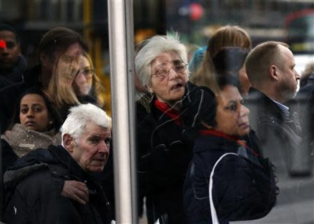 Commuters wait to board buses during London Underground strikes at Kings Cross underground station in London February 6, 2014. REUTERS/Olivia Harris