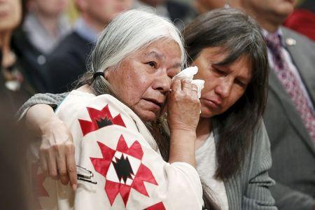 Residential School survivor Lorna Standingready (L) is comforted during the Truth and Reconciliation Commission of Canada closing ceremony at Rideau Hall in Ottawa, June 3, 2015. REUTERS/Blair Gable