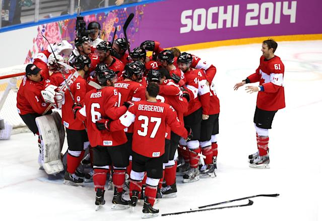 SOCHI, RUSSIA - FEBRUARY 23: Canada players celebrate their 3-0 victory during the Men's Ice Hockey Gold Medal match against Sweden on Day 16 of the 2014 Sochi Winter Olympics at Bolshoy Ice Dome on February 23, 2014 in Sochi, Russia. (Photo by Streeter Lecka/Getty Images)