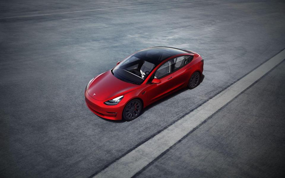 "<p>Among the more affordable options in the electric-vehicle marketplace, the <a href=""https://www.caranddriver.com/tesla/model-3"" rel=""nofollow noopener"" target=""_blank"" data-ylk=""slk:2021 Tesla Model 3"" class=""link rapid-noclick-resp"">2021 Tesla Model 3</a> is without doubt the one with the most name recognition. It borrows some styling cues from the company's <a href=""https://www.caranddriver.com/tesla/model-3"" rel=""nofollow noopener"" target=""_blank"" data-ylk=""slk:Model S sedan"" class=""link rapid-noclick-resp"">Model S sedan</a> and <a href=""https://www.caranddriver.com/tesla/model-x"" rel=""nofollow noopener"" target=""_blank"" data-ylk=""slk:Model X SUV"" class=""link rapid-noclick-resp"">Model X SUV</a>, but goes its own way with a unique interior design and an all-glass roof. Acceleration is quick, and the Model 3's chassis is playful as well—<a href=""https://www.caranddriver.com/reviews/a23685454/2018-tesla-model-3-dual-motor-performance-electric-car-acceleration/"" rel=""nofollow noopener"" target=""_blank"" data-ylk=""slk:especially the Performance model"" class=""link rapid-noclick-resp"">especially the Performance model</a>'s, which receives a sportier suspension and a track driving mode. But EV buyers are more likely interested in driving range than speediness or handling, and the Model 3 delivers there too. The base model offers up to 263 miles of driving range according to the EPA, and the more expensive Long Range model can go up to 353 per charge.</p><p><a class=""link rapid-noclick-resp"" href=""https://www.caranddriver.com/tesla/model-3"" rel=""nofollow noopener"" target=""_blank"" data-ylk=""slk:Review, Pricing, and Specs"">Review, Pricing, and Specs</a></p>"