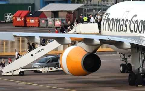 Thomas Cook - Credit: OLI SCARFF/ AFP